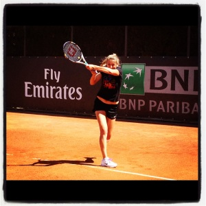 Vika Azarenka swings her Wilson Juice tennis racket
