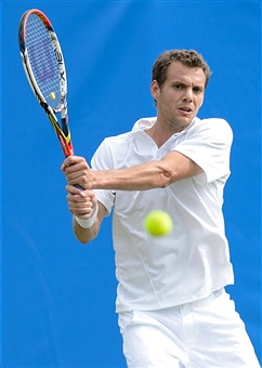 Paul Henri Mathieu swings his Wilson Steam tennis racket