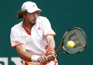 Guillaume Rufin swings his Wilson Blade tennis racket